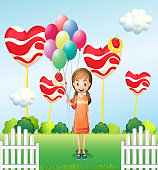 Girl in the candyland with eight balloons