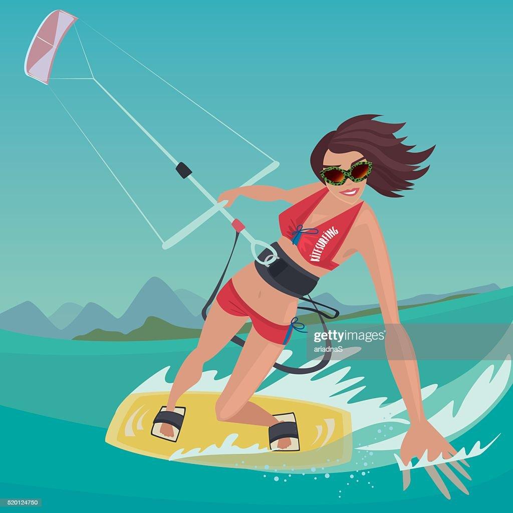 Girl is engaged in kitesurfing