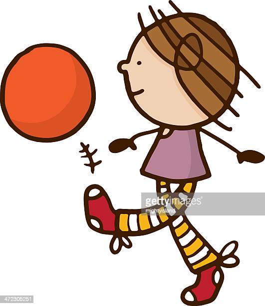 Girl kicking a ball