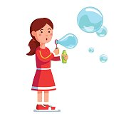 Girl kid blowing bubbles holding bottle with soap