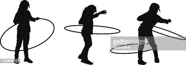 girl playing hula hoop - plastic hoop stock illustrations
