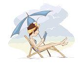 Girl reading a book on the beach