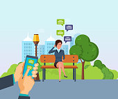 Girl resting in park, communicate by phone, through messenger