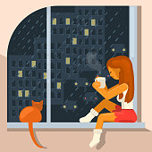 girl sits on the windowsill