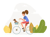 Girl with a dog riding a bicycle - vector