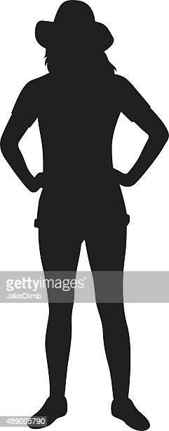 腰に手を当てる女性のシルエット