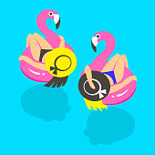 Girls on an inflatable pink flamingo in summer of swims and rests