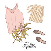 Girls outlook: shorts, shoes and top in pastel colors, decorated with palm leave. Trendy fashion illustration. Magazine article flatlay  print of modern apparel. Business watercolor art.