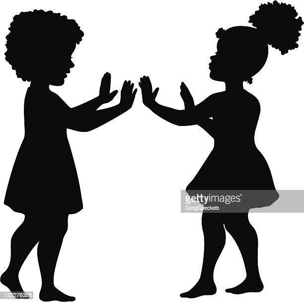 Girls playing hand clapping game