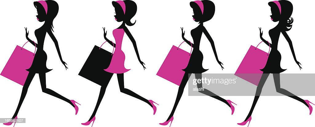 Girls running with shopping bags