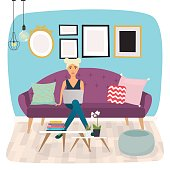 Girls working at home. Young woman sitting on a sofa