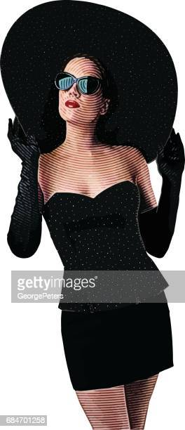 Glamorous well dressed woman wearing wide brim hat and evening gloves