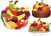 Glass, ceramic and wooden fruit bowls