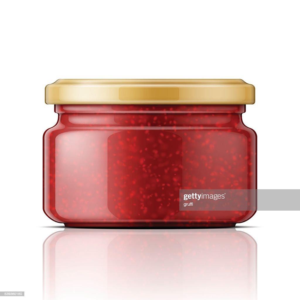 Glass jar with raspberry jam.