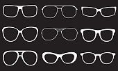 Glasses set. Sunglasses white silhouettes. Vector illustration.