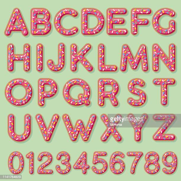 glazed strawberry donut alphabet - sugar sprinkles stock illustrations