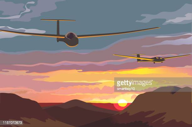 gliders over countryside - gliding stock illustrations
