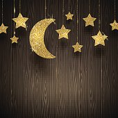Glitter gold stars and moon on a wooden texture background
