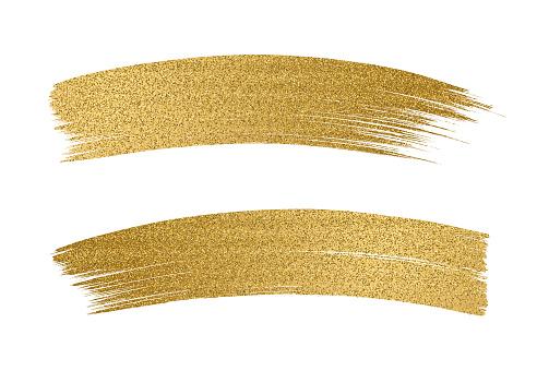 Glitter golden brush stroke on white background - gettyimageskorea