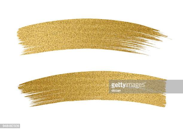 glitter golden brush stroke on white background - gold colored stock illustrations