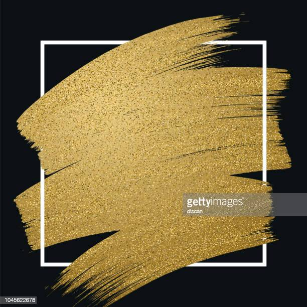 Glitter golden brush stroke with frame on black background