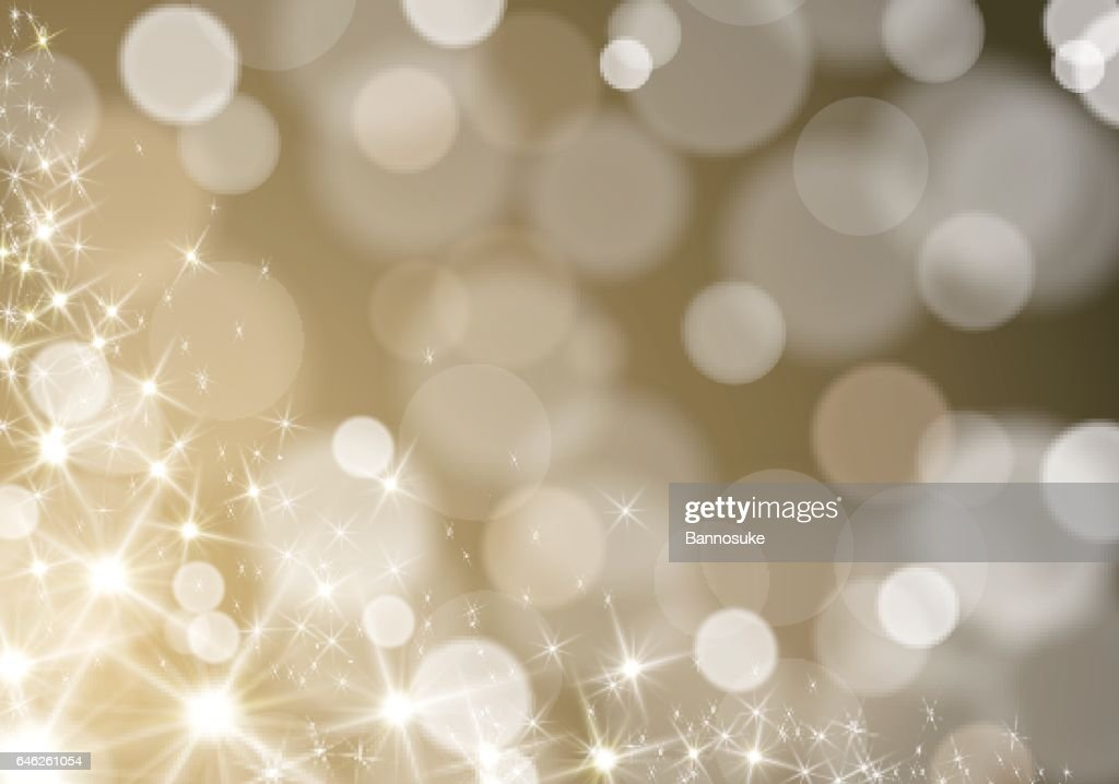 Glitter lights wave on defocused blurred gold background