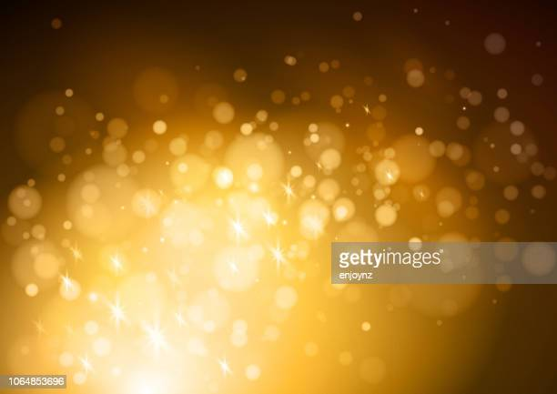 glittering abstract background - gold coloured stock illustrations