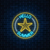 Glowing neon sign of summer begin party with sea star symbol in circle frames on dark brick wall background.