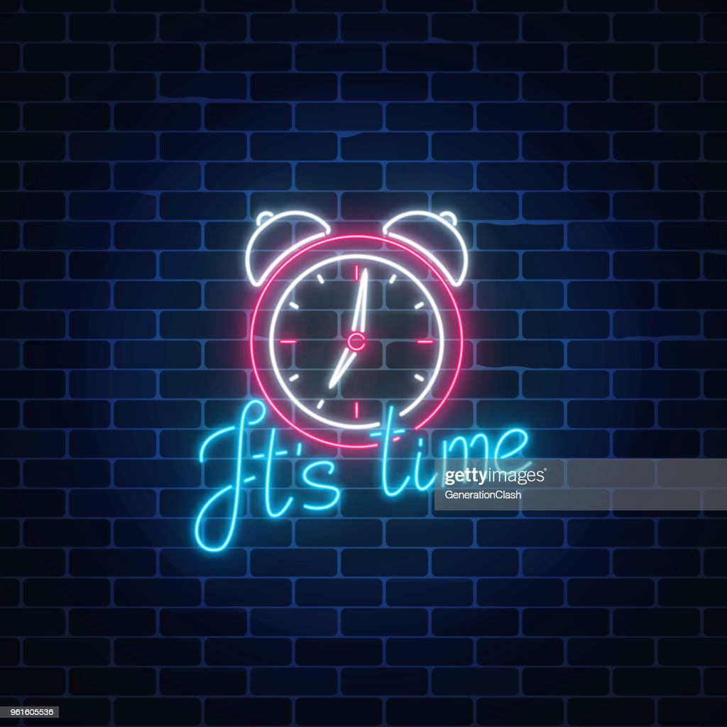 Glowing neon sign with alarm clock and cheering inscription on dark brick wall background. Call to action symbol.