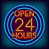 Glowing open 24 hours neon sign.