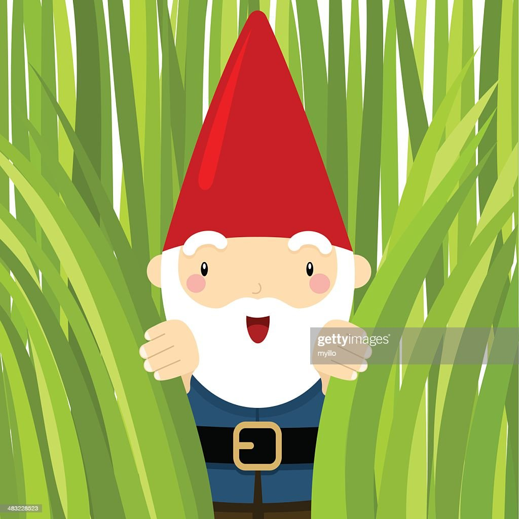 Gnome in the garden. Peeking grass