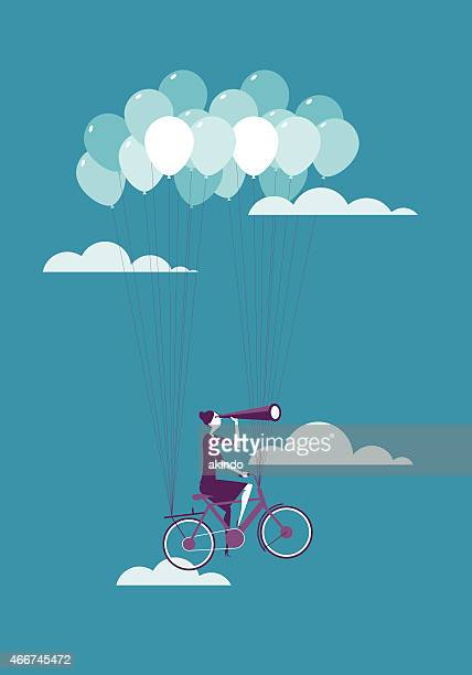 Going Up! Businesswoman Lifted by Balloons