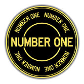 Gold and black color sticker in word number one on white background