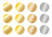 Gold and silver metal badges over white