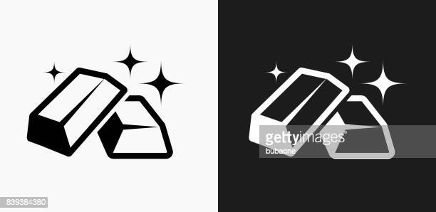 gold bars icon on black and white vector backgrounds - gold rush stock illustrations