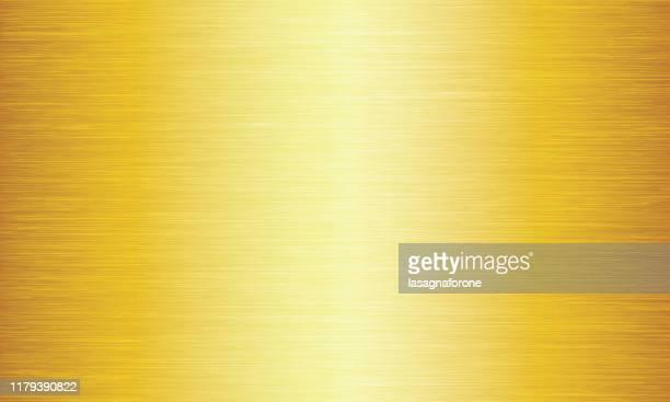 gold brushed metal texture abstract vector background - gold coloured stock illustrations
