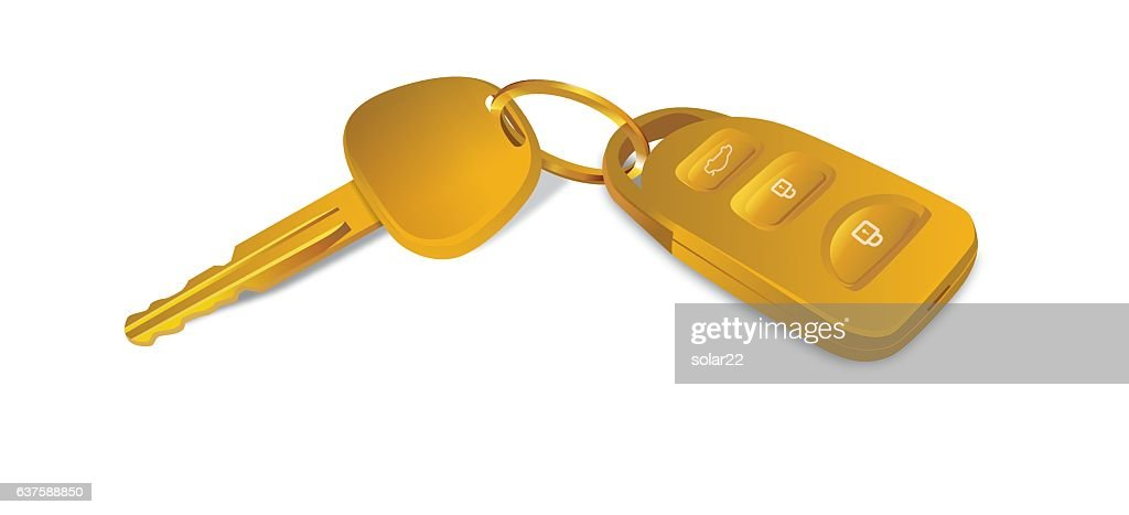 Gold car keys isolated on white.