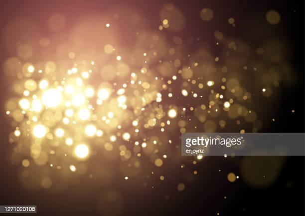 gold weihnachten funkelnden glitzer design hintergrund - unscharf gestellt stock-grafiken, -clipart, -cartoons und -symbole