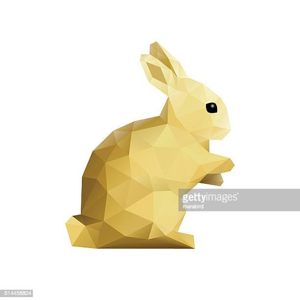 gold easter low poly rabbit on flat white background - easter bunny stock illustrations