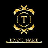 Gold Elegant letter T. Graceful style. Calligraphic beautiful logo. Vintage drawn emblem for book design, brand name, business card, Restaurant, Boutique, Hotel. Vector illustration