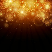 Gold fireworks on a black vector background
