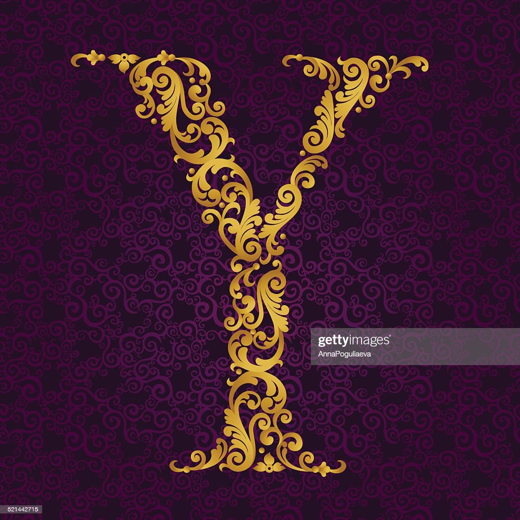 Gold font type letter Y, uppercase.