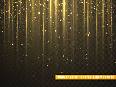 Gold glitter particles on transparent background. Golden glowing lights magic effects.