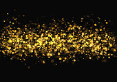 Gold glitter texture. Irregular confetti border on a black background. Christmas or party flyer design element. Vector illustration