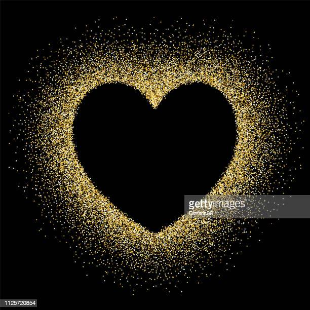 gold glitter with heart shape empty space on black background - black background stock illustrations