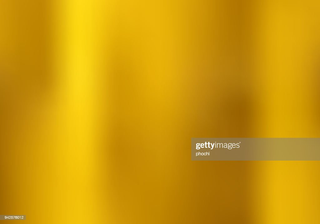 Gold gradient blurred style background. golden metal material texture.