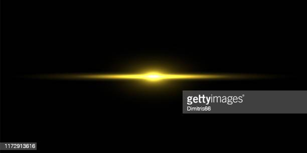 gold light beam on black background - lens flare stock illustrations
