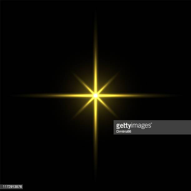 gold light star on black background - shiny stock illustrations