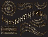 gold musical design elements on black - vector set