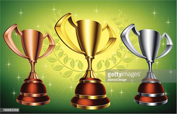 gold silver and bronze trophy cups - bronze medal stock illustrations